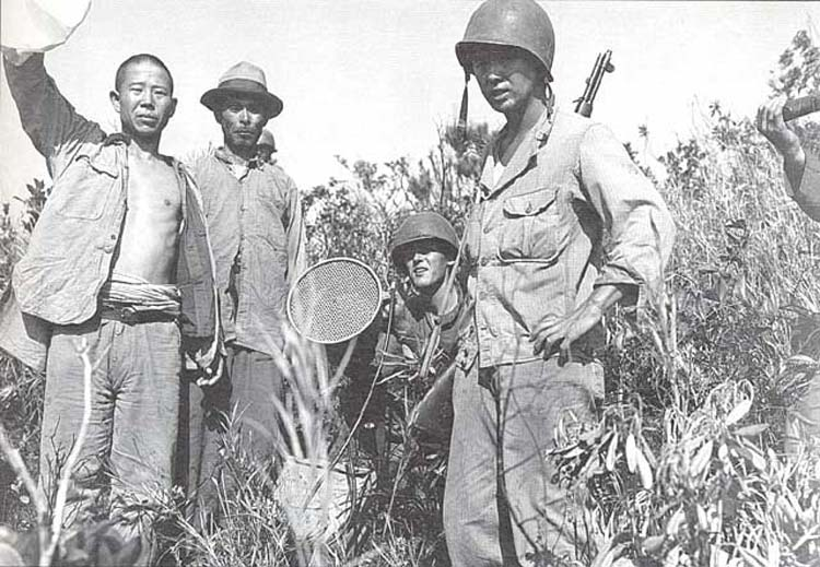Nisei interpreter calls on natives to come out of cave, Okinawa