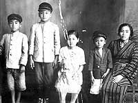 Takejiro Higa with his mother, Ushi Higa, and his cousins