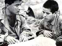 Warren Higa questions a Japanese prisoner, Okinawa