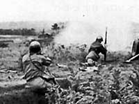 Antitank gunners of the 96th Division fire at Japanese positions in Mashiki