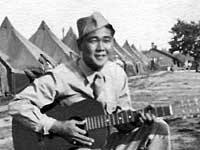 Ray Nosaka at Camp McCoy with guitar