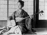 Japanese woman holding a samisen