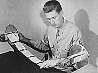 V-mail microfilm is inspected and cut into individual letters