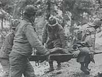 Medics carrying wounded nisei, France