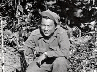 Lt. Ralph Yempuku relaxing behind the enemy line in Central Burma.