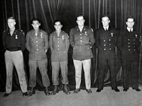 Sgt. Fumio Kido and S/Sgt. Dick Hamada are awarded the Soldier's Medal in Washington, D.C. on January 3, 1946 by General MacGruder. l-r: Captain Koger, S/Sgt. Dick Hamada, Sgt. Fumio Kido, Blankenship, Morde and Peters.
