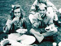 Picnic on the lawn of Camp Savage in front of the library, during a break