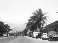 Kahului, Maui. Puunene Store, left. Kahului Railroad Station and post office, right. Circa 1930s.